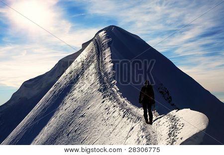 Alpinist climbing Monch Peak, Berner Oberland, Switzerland - UNESCO Heritage