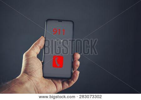 Male Hand Using Emergency Call 911 App Smart Phone