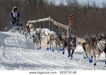 Duluth, Mn - January 27, 2019: Blake Frekings Team Crosses Bridge During The John Beargrease Sled Do