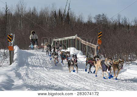 Duluth, Mn - January 27, 2019: Erin Altemus Team Crosses Bridge During The John Beargrease Sled Dog