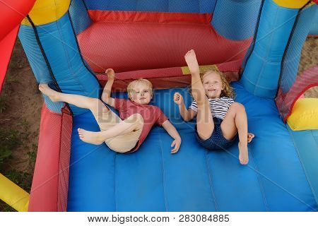 Charming Little Boy And Girl Having Fun In Leisure Center For Kids. Child Sport Activity On Outdoor
