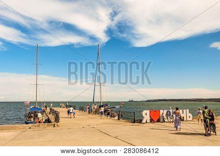 Kerch City, Republic Of Crimea - July 17, 2018: Crimean Kerch Promenade With Berth For Pleasure Boat