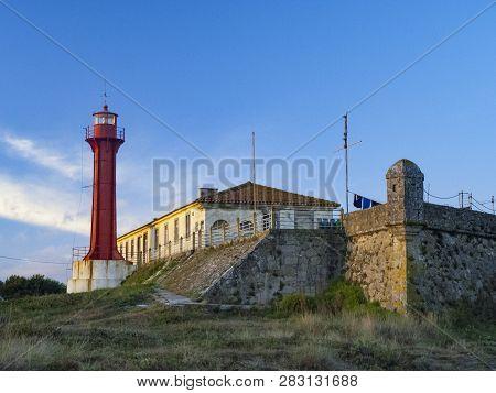 The Farol De Esposende (esposende Lighthouse) Set In Front Of The Fort Of Sao Joao Baptista De Espos