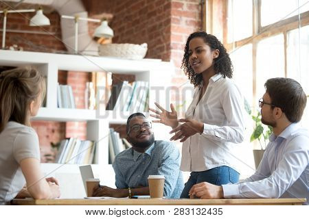 Ambitious African Black Female Employee Speaking At Diverse Meeting