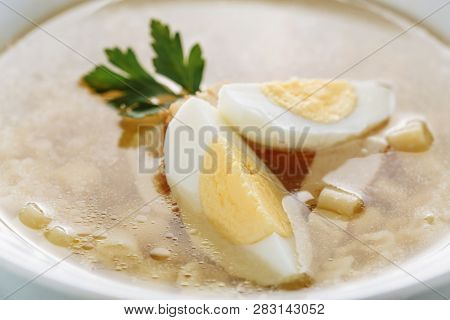 Chicken Noodle Soup With Egg Closeup Side View