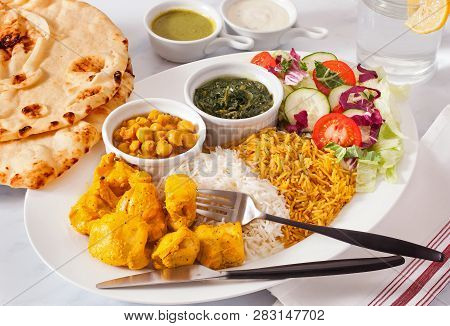 Afghan Food Entree Of Chicken Kabob With Naan Bread And Side Orders