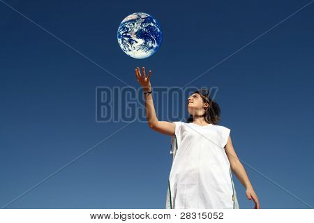 girl holding earth (enviromental protection)