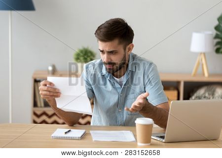 Confused Frustrated Man Holding Mail Letter Reading Shocking Unexpected News