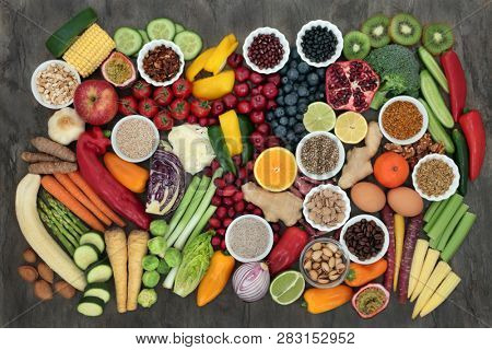 Large super health food collection with fruit, vegetables, seeds, grains, dairy, coffee, nuts, legumes, grains, herbs & spices. High in antioxidants, protein, anthocyanins, vitamins & dietary fibre.