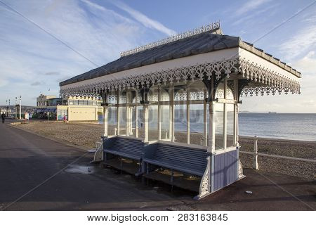 Weymouth, United Kingdom - December 26, 2017 - Victorian Shelter Infront Of The 1920s Art Deco Style