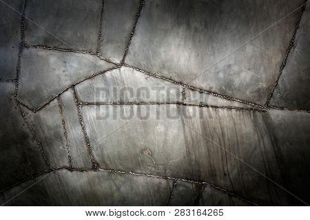 Welded metal background