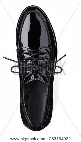 Footwear Concept. Black female classic leather shoes isolated on the white background