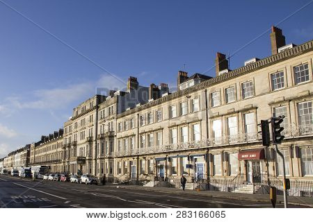 Weymouth, United Kingdom - December 26, 2017 - Row Of Guesthouses And Hotels In Sunlight Along The E