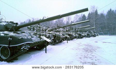 T 34 Battle Tanks Stand In A Row. Winter Snowfall. Soviet Medium Tank T-34 Of The World War Ii