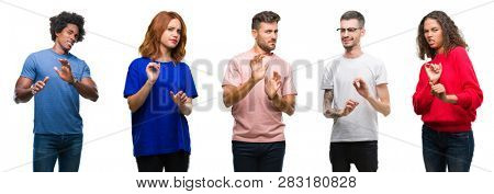 Composition of african american, hispanic and caucasian group of people over isolated white background disgusted expression, displeased and fearful doing disgust face because aversion reaction