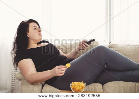 Overeating, Sedentary Lifestyle, Bad Habits, Food Addiction, Eating Disorders. Fat Overweight Woman
