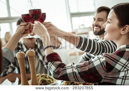 Cheerful Bearded Man Raising Hand With Bocal