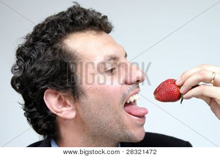 man with strawberries, healthy food photo