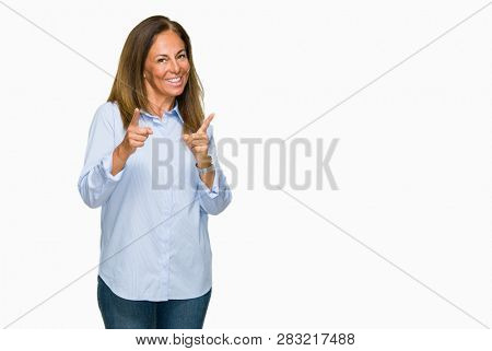 Beautiful middle age business adult woman over isolated background pointing fingers to camera with happy and funny face. Good energy and vibes.