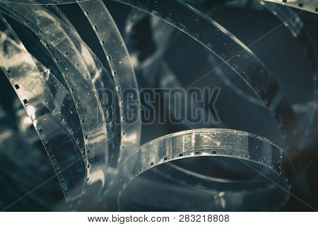 Aged Old Cinema Rolls, Retro Reels, Filmstrip, Photographic Film With Hard Grain, Dust And Scratches