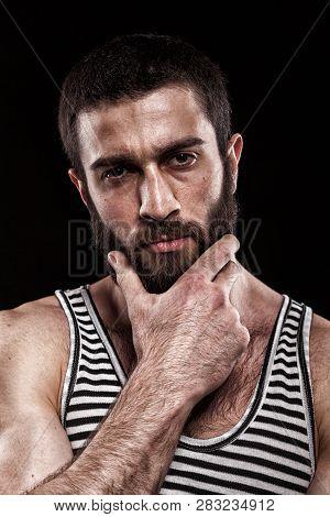 Emotional Portrait Of Beardy Georgian Man With A Hairy Chest. Closeup Studio Portrait Of Beardy Guy