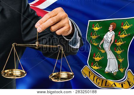 Judge Is Holding Golden Scales Of Justice With British Virgin Islands Waving Flag Background. Equali