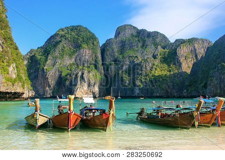 Longtail Boats Anchored At Maya Bay On Phi Phi Leh Island, Krabi Province, Thailand. It Is Part Of M