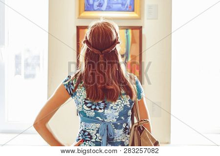 Novokuzneck, Russia - 01.09.2018: Young Woman Looking At Modern Painting In Art Gallery