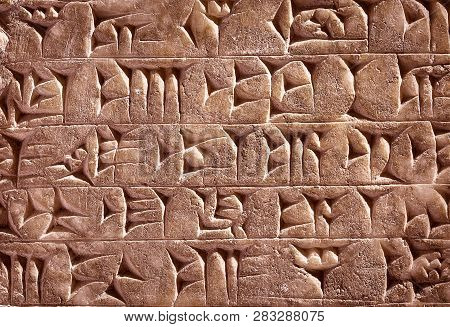 Ancient Cuneiform From Babylon In Mesopotamia. Assyrian And Sumerian Writing Carved On Clay Or Stone