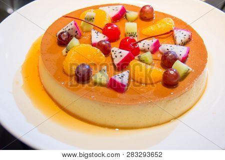 A Caramel Custard With Fresh Mixed Fruit