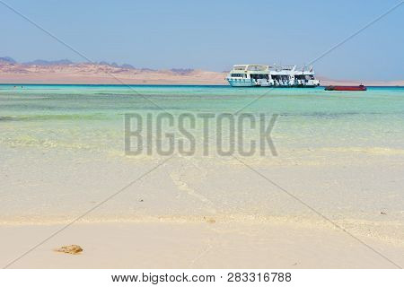 White Boat In Turquoise Sea Under Sunlight