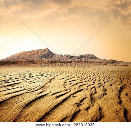 Egyptian Rocky Desert At Sunset In Summer