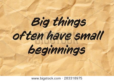Motivational Quote Big Things Often Have Small Beginnings Printed On Crumpled Brown Paper.