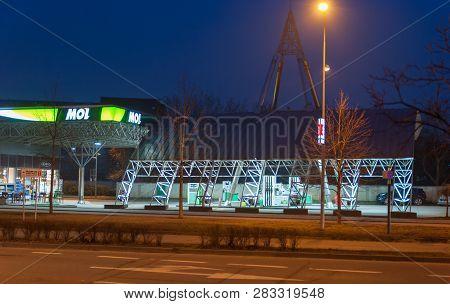 Novi Sad, Serbia. February - 08. 2019. Night Image Of Mol Gas Or Petrol Station With Film Grain. Edi