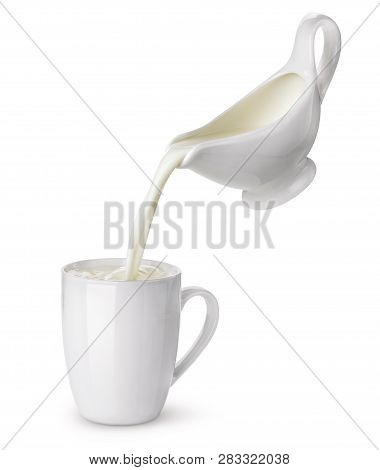Pouring Cream From Creamer Into Cup With Splash Isolated On White Background, Flowing Milk