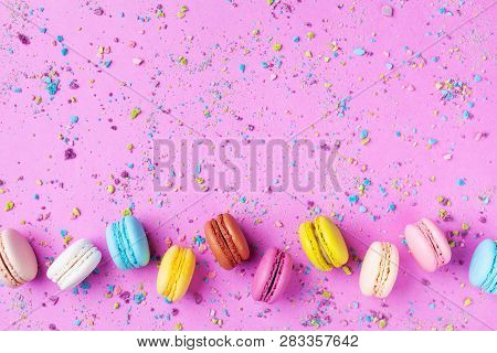 Colorful Dessert Macaron Or Macaroon On Pink Punchy Background Top View. Flat Lay.