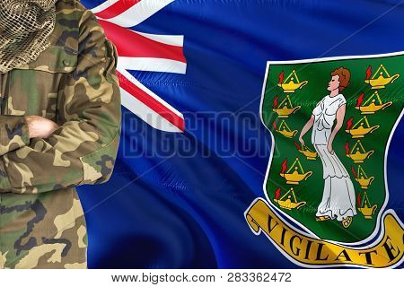 Crossed Arms Soldier With National Waving Flag On Background - British Virgin Islands Military Theme