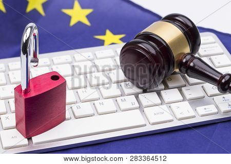 Padlocks On Laptop With Judge Hammer For Data Protection Concept