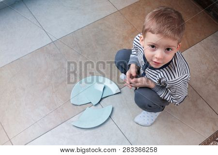 the child broke broke the dishes. dropped on the floor. little brat poster