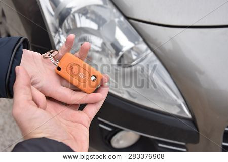 Car Sales. One Person Sells Car And Gives The Key To The New Owner - Image
