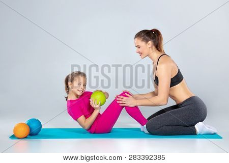 Sportive Woman And 10 Years Old Girl With Slamballs