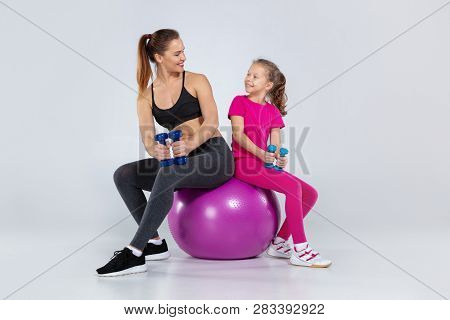 Athletic Woman And Nice Girl Doing Sport Exercises