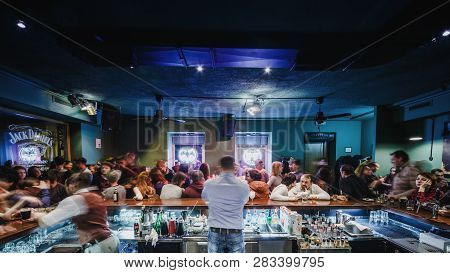 Moscow, Russia - February 22, 2015: Upscale Bar Is Busy With A View Behind Bartender Working For A C