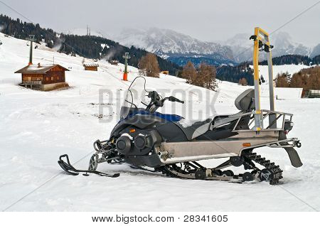 Snowmobile On Alps In Winter Time