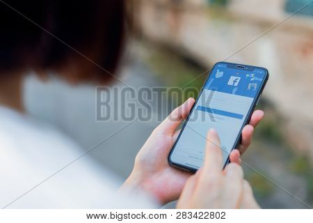 Bangkok, Thailand - March 11, 2019 : Hand Is Pressing The Facebook Screen On Apple Iphone X ,social