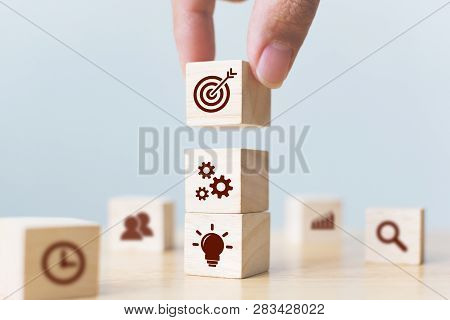 Concept Of Business Strategy And Action Plan. Businessman Hand Putting Wood Cube Block On Top With I