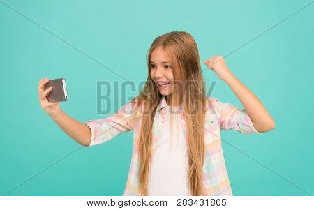 That Is Just Amazing. Watching Video On Mobile Device. Little Girl Using Mobile Phone. Small Girl Ch