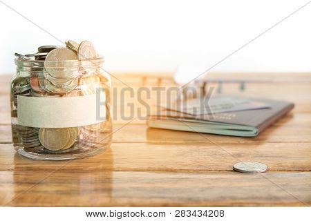Money Savings Concept. Collecting Money In The Money Jar For Your Concept. Money Jar With Coins, Air