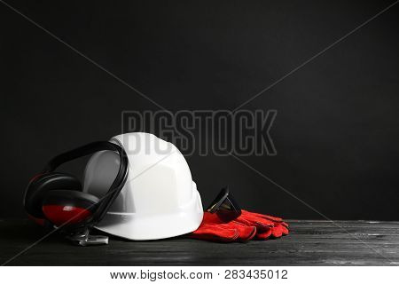 Composition With Safety Equipment On Table. Space For Text