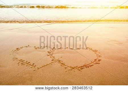 Love By Hand Write Heart On Sand At The Beach In Valentines Day